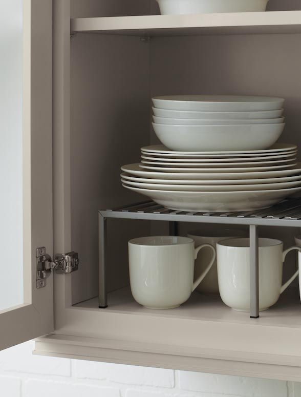 Kitchen Storage Tip: Maximize cabinet storage by taking advantage of vertical space & stacking items.