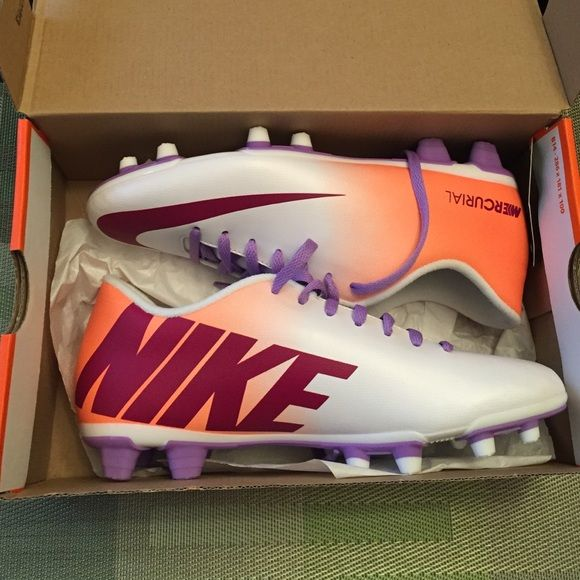Girls soccer cleats Brand new girls soccer cleats. Never been worn. In mint condition. They are orange and and white with purple laces and purple Nike logo. Price is negotiable. Nike Shoes Athletic Shoes