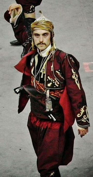 A folk dancer in a traditional costume of the people's militia from the Kütahya province.  Clothing style: ca. 1900.  These is a (good)  recent workshop-made copy, as worn by folk dance groups.