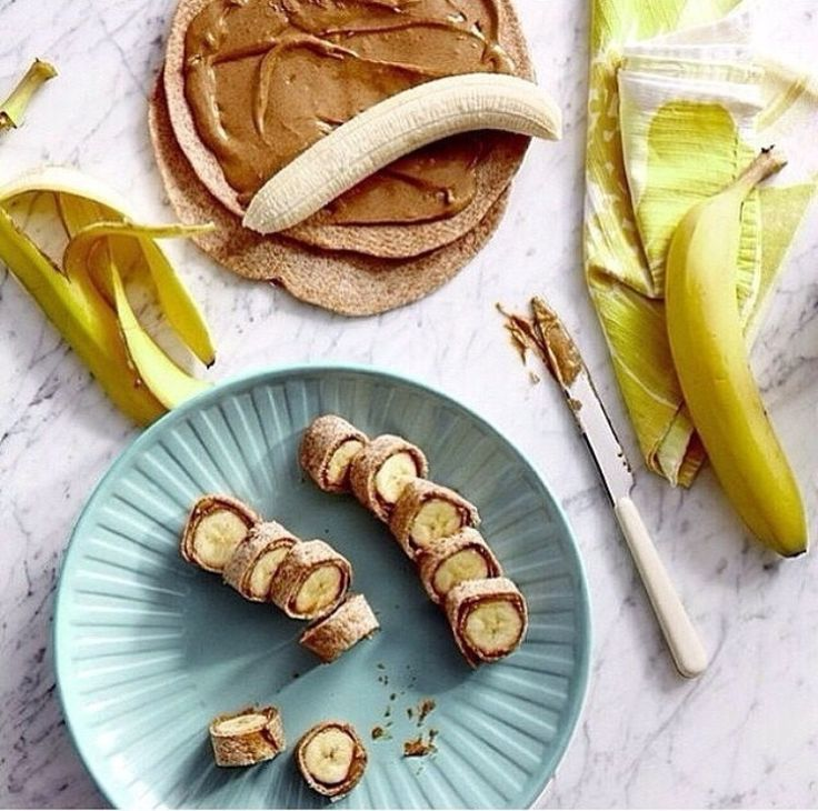 Wheat tortilla wit Nutella spread or peanut butter and a whole banana