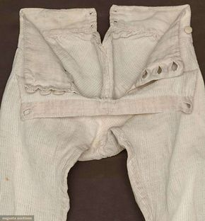"""White home spun raised pin-stripe linen, cut on cross grain, wide W band w/ 3 CF self-covered buttons & pair smaller side buttons to hold up wide fall, 2 pair sewn eyelets at CB W band, 4 buttons & tabs for knee buckles on each leg, gathered baggy seat, W 27+"""", Inseam 17.5"""", excellent. James Kochan - Don Troiani Collections Sold at Augusta Auctions"""
