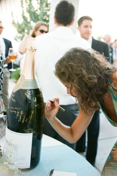 Bottle of Champagne Choose your favorite bottle of champagne or wine. Have guests sign it and keep it for a special anniversary. You can display it in your house until you break it open for you 10th, 25th or maybe even your 50th anniversary. Once it's empty, you can still display it. Just add some sand to weigh it down and use as a piece of decor.