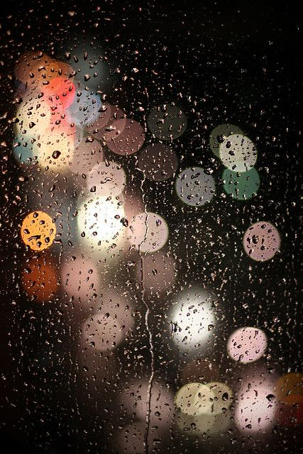 I love that the lights are blurred and the raindrops are so defined..  raindrops are underrated !!