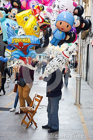 Man who is sealing helium balloons. The photography is taken in Ronda Andalusia Spain on the 24th of december 2015