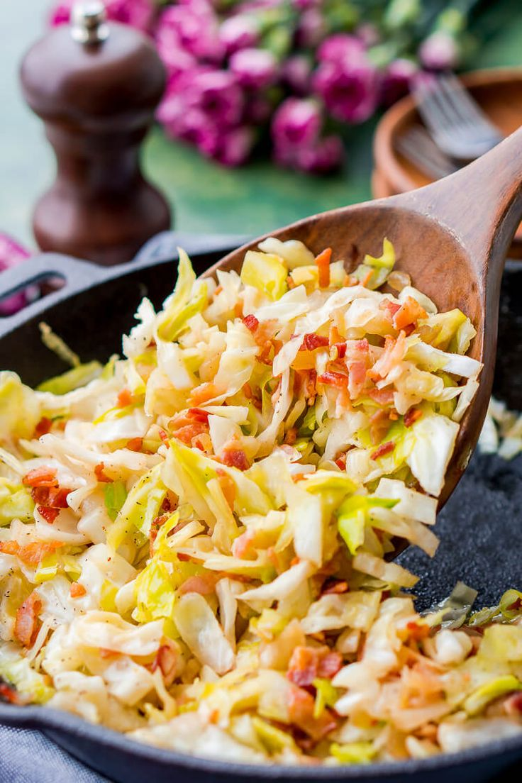 Irish Fried Cabbage and Bacon is a simple recipe that's pan fried in bacon grease and loaded up with bacon pieces and onion and seasoned with brown sugar, salt, and pepper.