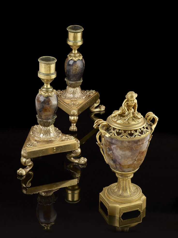 Lots 96 and 97 to include a good pair of Blue John ormolu-mounted candlesticks and a good ormolu-mounted Blue John cassolet or urn and colver