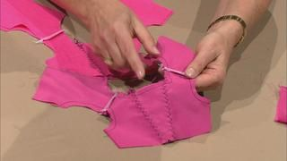 Nancy and designer Joan Hinds create adorable doll clothes that are easy to sew and incorporate fast closures for little fingers. Learn to make impressive special occasion clothing including a fairy princess dress, a cheerleader outfit, a snowy day ensemble, and a sweetheart dress. Sew gathers, sweet necklines, easy hems, fancy trim, and more.