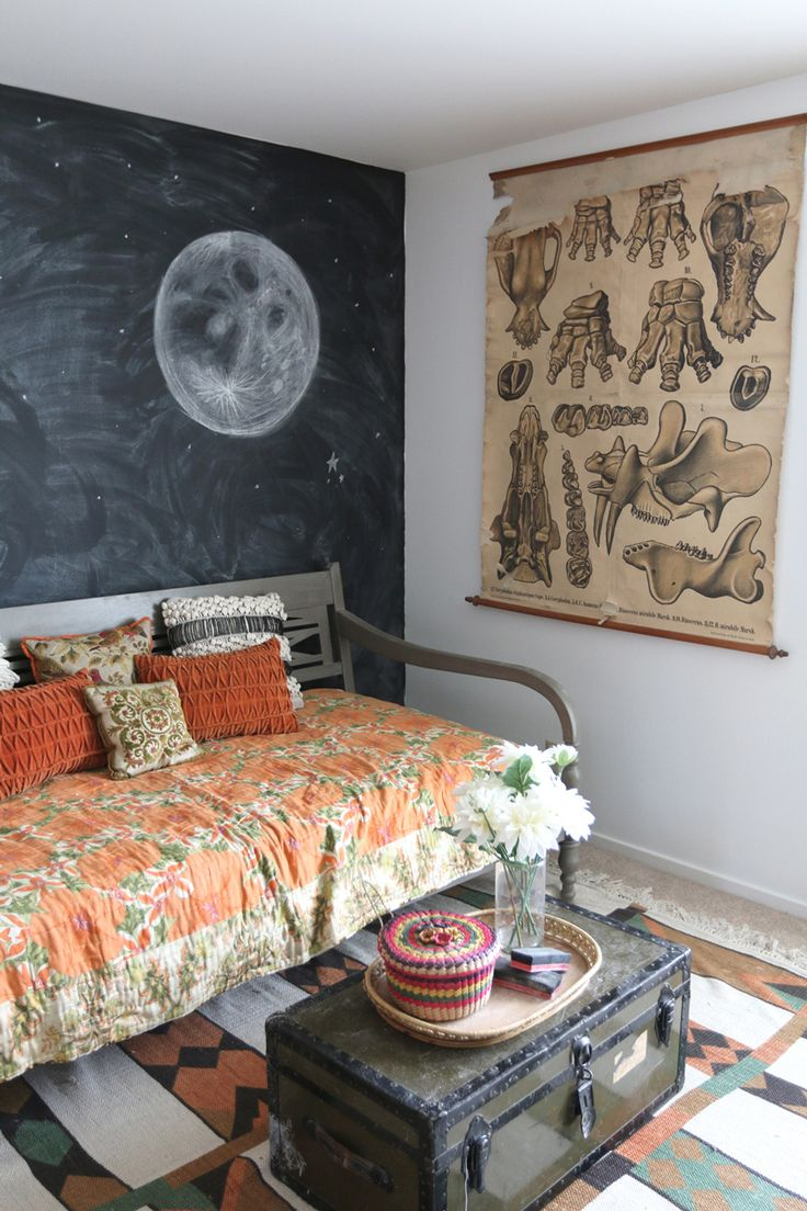 A Vintage Collector's Treasure-Filled Home in Salt Lake City | Design*Sponge. The chalkboard wall is pretty cool, and love how the orange and rust colours tie in with the throw on the bench, the rug and the poster.