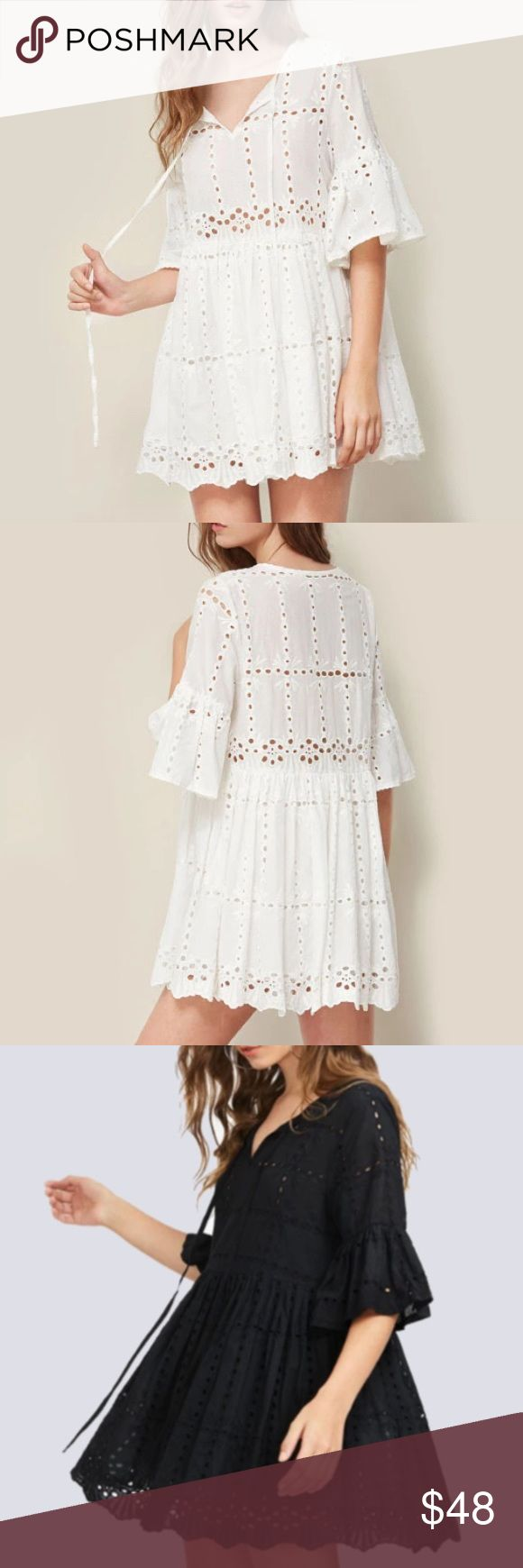 """Swingy Tieneck Tunic DRESS White Black Lace NEW BRAND NEW!! Soo pretty!! This swingy Tunic dress is simply sweet with all over scalloped lace detail.   S: Bust: 37.6""""/Length: 32.1"""" M: Bust: 39.2""""/Length: 32.6"""" L: Bust: 40.7""""/Length: 33.1""""  🌟🌟Item is Brand New, direct from the Manufacturer, & Sealed in Pkg. 🌟🌟 austin gal Dresses"""