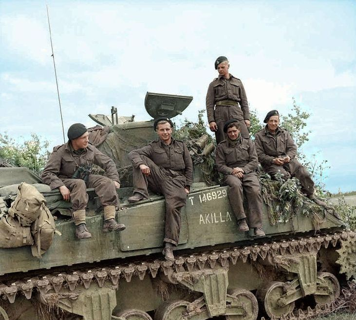 A Brit sherman crew during pose on their tank during the Battle of Normandy, summer of 1944.