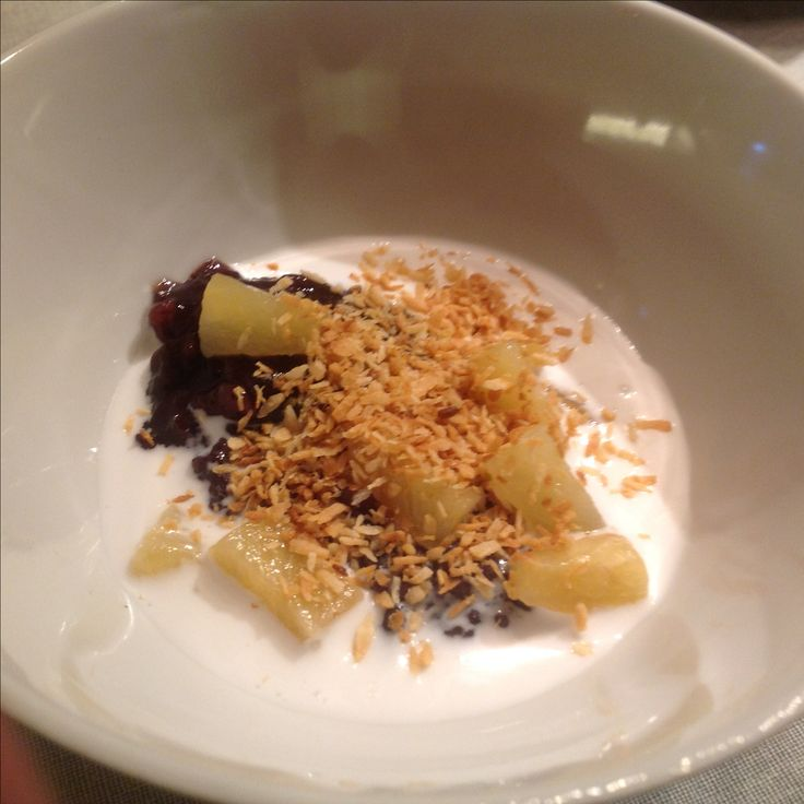 Black rice pudding with pineapple, coconut milk and roasted cococnut, delicious