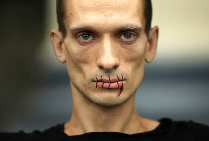 """Petr Pavlensky """"I wanted to make people physically feel, where their apathy and political indifference are leading at. People are hiding in their soft chairs in offices or at home, being afraid to go out and determine their own future, and I want to show them truth about their lives. Because their indifference today makes the prison state possible tomorrow."""""""