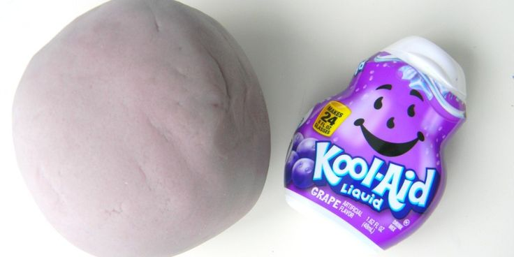 For this months sensory dough we made Grape Kool-Aid Scented Play Dough and played with heart shaped cookie cutters and molds!