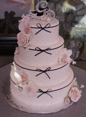 Tied with a Bow 2 - Fondant with silver scintillo dots, real ribbon, gumpaste flowers, and a chocolate topper.  The sun was really bright behind me so I was fighting shadows, this is the best pic I was able to get.
