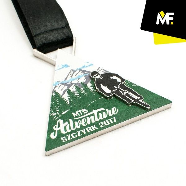 Medal for a bike rally.  #Medal made of metal with a dedicated one-sided print. An additional metal element in the shape of a cyclist was placed on the medal. #sport #athlete ##rally #bike# #adventure #eventplannner #eventplanning  #eventaward