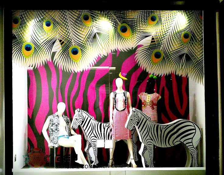 Fixtures; Stands Props; Form and decorative Lighting; Spotlight Color; Zebra strip ( pink, black, white) Line; vertical and horizontal lines Balance; Informal Emphasis; Pink zebra wall
