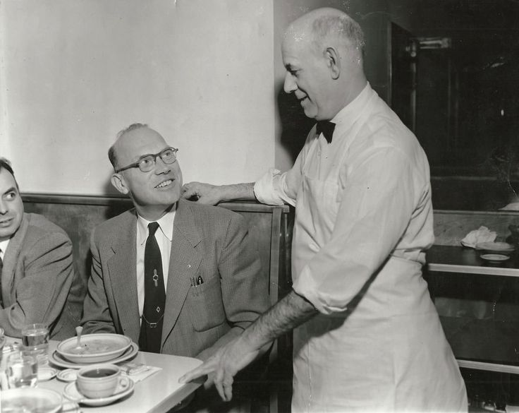 Alexander D. Cozanitis serving and talking to his customers at Kennett Kandy Kitchen. Alexander D. Cozanitis migrated from Andros Greece in 1921 and opened the Kennett Kandy Kitchen. The restaurant thrived until it was sold in 1972. The Half Moon restaurant occupies the site of the Kennett Kandy Kitchen and patrons can still see hints …
