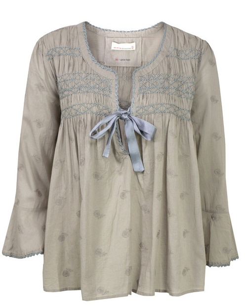 Baby doll top with embroidery and a bow