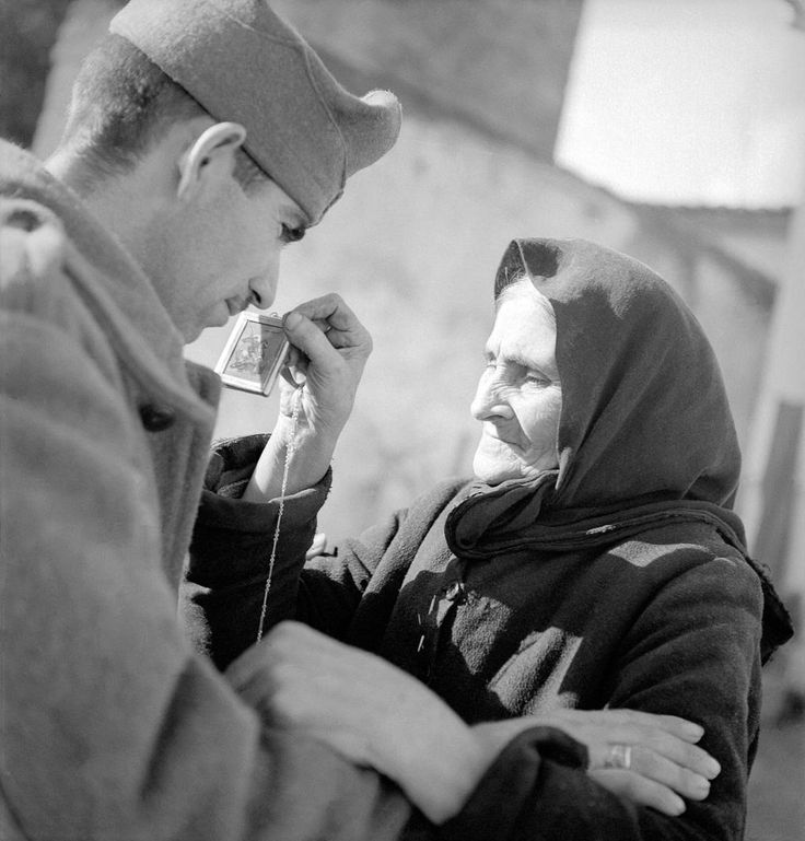 A Greek soldier tells his mother goodbye before leaving to fight the Italian invaders, 1940 - pin by Paolo Marzioli