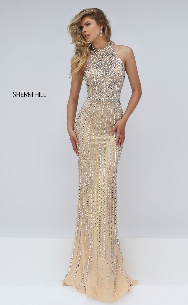 Flatter a slim line figure fabulously in the Sherri Hill 50248 halter neck prom dress. This sweetheart jersey gown showcases glorious beading on the bodice and illusion halter neckline, and on the semi-open back. A slim beaded band accentuates the waistline above the figure hugging full-length skirt. Horizontal lines of beads create a mesmerizing waterfall effect on the skirt.