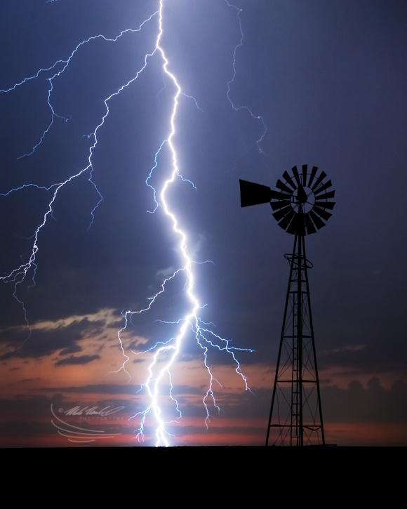 Cloud to ground lightening illuminate a windmill in SW Kansas