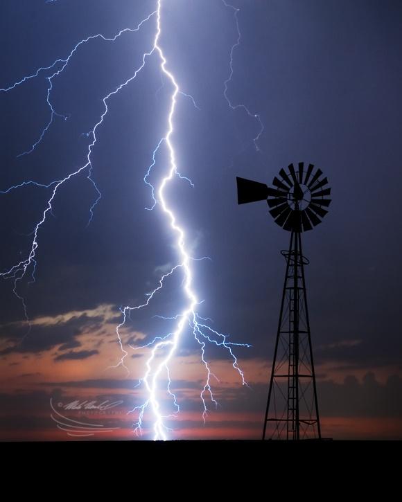 Cloud to ground lightening illuminate a windmill in SW Kansas