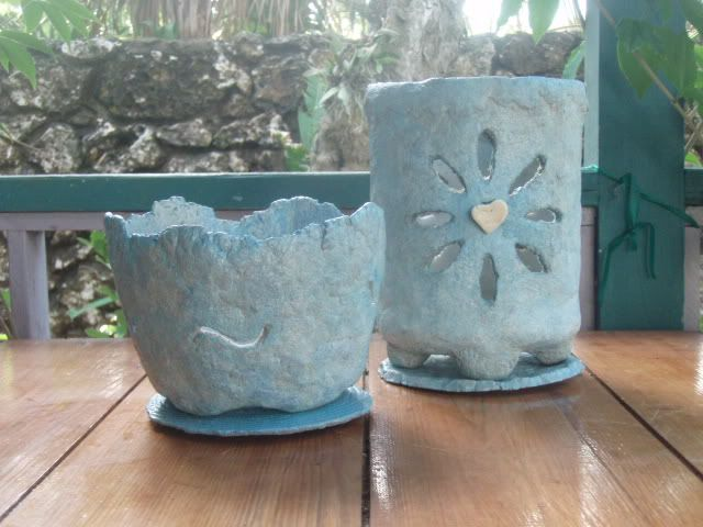 """Betty Mackey -- """"Papercrete is similar to hypertufa but uses shredded paper instead of the peat moss. The proportions are 2 parts Portland Cement, 2 parts (dry volume) finely shredded paper loosely packed, and 2 to 3 parts sand OR perlite. Papercrete has a fairly smooth consistency and the pape..."""