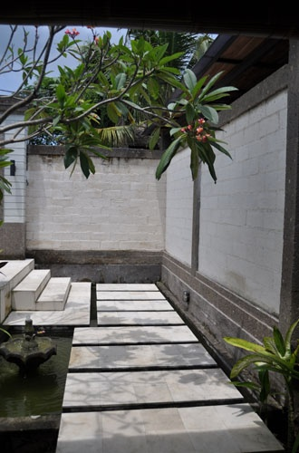 Entrance - Step into the living room over a fish pond
