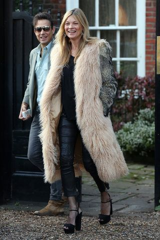 Kate Moss never holds back when it comes to statement coats.