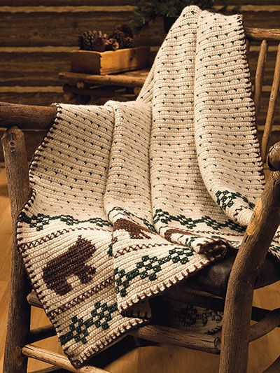 """Watching out for bears? Invite them inside on this warm and woolly afghan. This e-pattern was originally published in the October 2010 issue of Crochet World magazine. Size: 45"""" x 65"""". Made with medium (worsted) weight yarn and size H/8/5mm hook. Skill Level: Intermediate"""