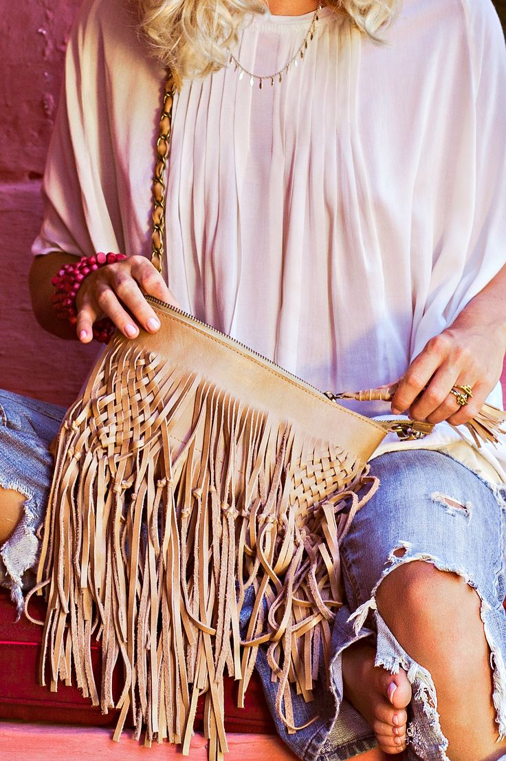 Wild Heart chain strap cross-body is a must have for your Boho Chic party. It will compliment a pair of jeans, your favorite maxi skirt or your favorite bohemian dress. The handcrafted leather fringe only adds richness and makes it a perfect night out bag.