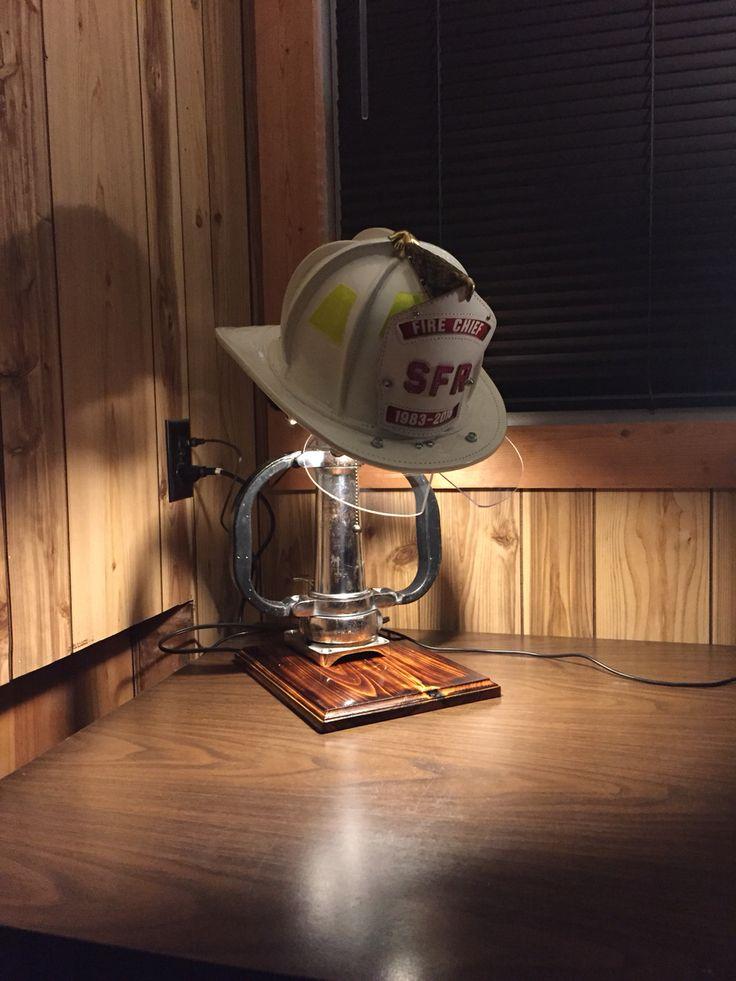 Fire helmet display with lamp