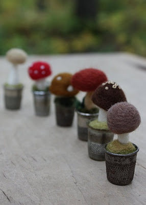 Felted mushrooms in thimbles.
