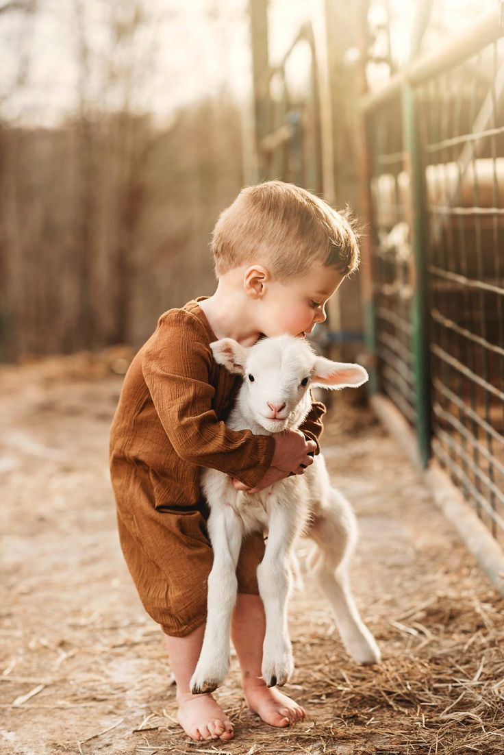 Boy And Lamb Spring Pictures Pictures From Around The Farm Childhood And Pet Pictures Baby Lamb Kid Organic Clothing Suc Animals Cute Baby Photos Cute Kids