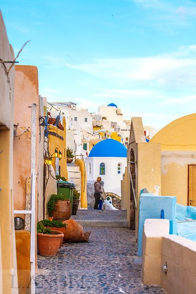 Santorini; Greece; Aegean Sea; Oia town; blue church; sunset