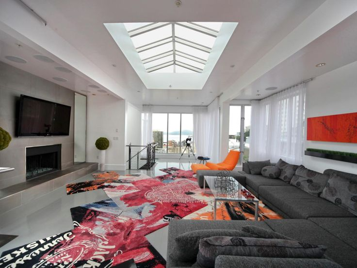 Since this San Francisco apartment has a skylight, you know it must be the penthouse. The living room, featured on HGTV's Million Dollar Rooms, features strong lines, sleek furniture and pops of bright colors.