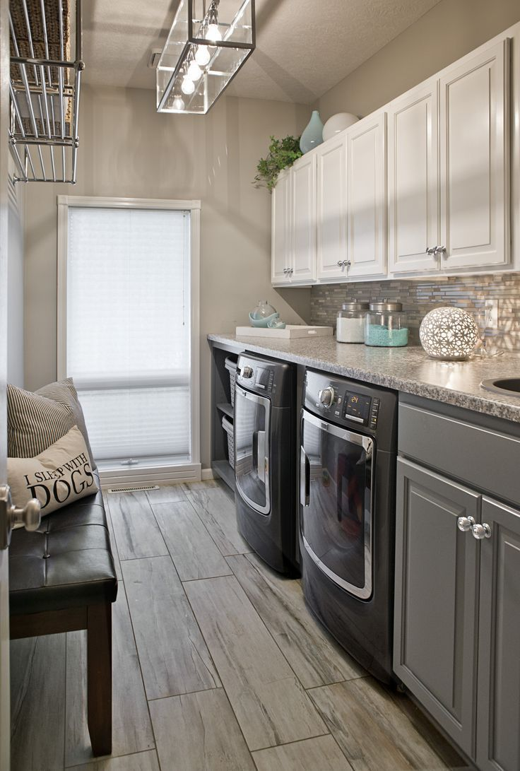 Long Narrow Laundry Room Lots Of Counter Space Wood Look Ceramic Tile Gauntlet Gray Cabinets G Laundry Room Tile Laundry Room Flooring Modern Laundry Rooms