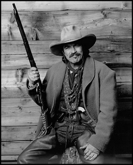 "Tom Sellick in ""Quigley Down Under"" It is a 1990 western film set in Australia's outback. Starring Tom Selleck, Alan Rickman and Laura San Giacomo, it was directed by Simon Wincer. Matthew Quigley is a cowboy and sharpshooter from America with a keen eye and a specially modified rifle with which he can shoot accurately at extraordinary distances."