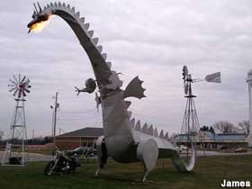 Dragon breathes flames. Rock Island Ave., Vandalia, IL Directions: I-70 exit 61 and drive south toward the Wal-mart. Make a left at the light onto US Hwy 40/Veterans Ave. Dragon will be on your right in about a mile, at the corner of Rock Island Ave. Tokens at the liquor store across the street, or behind the dragon at Kaskaskia Supply. If the dragon is out of breath, let Kaskaskia know! Hours: Tokens available until the liquor store closes. Admission: Free to view; $1 per token for flames.