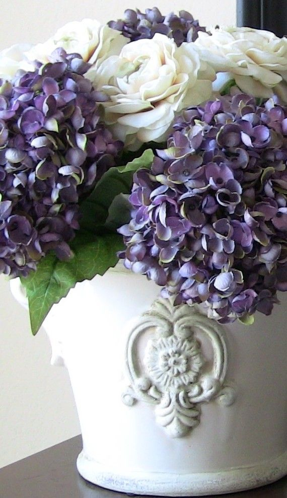 Another pretty centerpiece idea: Lavender and white flowers ,inside a rustic white pot