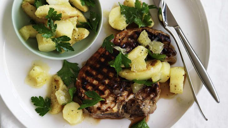 Neil Perry's barbecued pork chops with apple, potato, parsley and lemon salad.