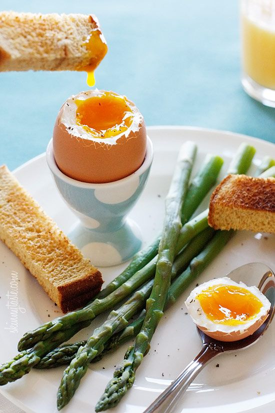 """Strips of whole wheat toast """"soldiers"""" and crisp tender asparagus dipped into a soft boiled egg, if that's not the perfect Spring breakfast, I don't know what is!"""