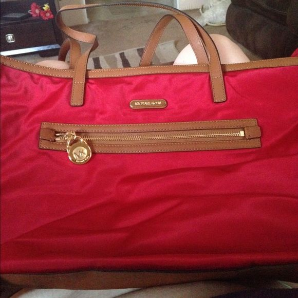 red michael kors bag slightly used but super cute! canvas material so easy to clean! Michael Kors Bags