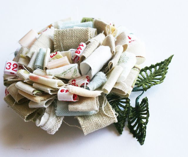 Fabric scrap flower for Haiti by Rebecca Sower, via Flickr