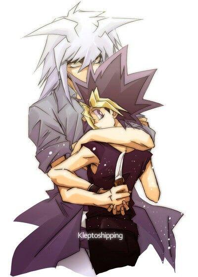 yami bakura hugged yugi to stab him just a fanart he