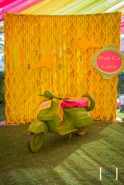 Scooter Photobooth , Maa ki Laadli , green and yellow photobooth , marigold decor , quirky photobooth idea, funky mehendi decor