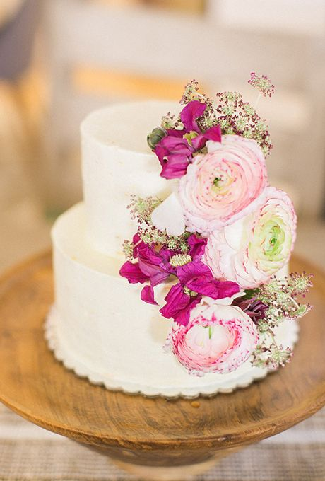 """Brides.com: 23 Cakes We Love for Summer Weddings A two-tiered confetti-inspired """"painted"""" wedding cake created by Philomena Bake Shop.Photo: Lauren Gabrielle"""