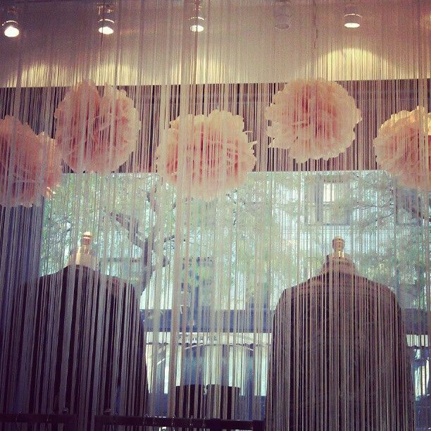 Great idea for breaking up the window display. Great lighting to make the window pieces stand out and the beads add a break without making the room look smaller.