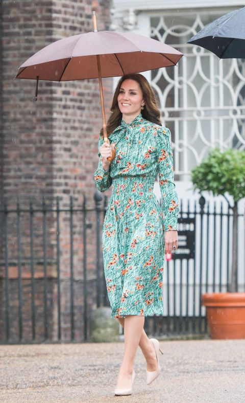 Kate Middleton wore a green floral Prada dress to visit Princess Diana's memorial at Kensington Palace with Prince Wiliam and Prince Harry.