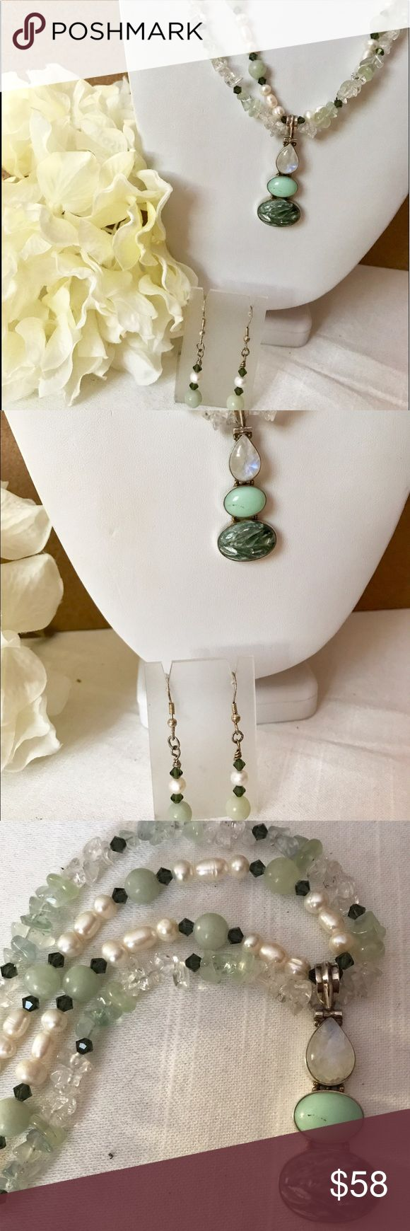 "Double strand pearl pendant set Double strand necklace and earring set. White freshwater pearls, emerald Swarovski crystals, jade beads, clear and jade quartz chips, sterling silver closure, matching earrings with ss hook, necklace is 18"" with 2"" pendant drop, earrings are 2"" long, the pendant is sterling silver with moonstone, jade and I can't remember the other stone name, price for set Jewelry"